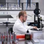 scientist in laboratory working on computer