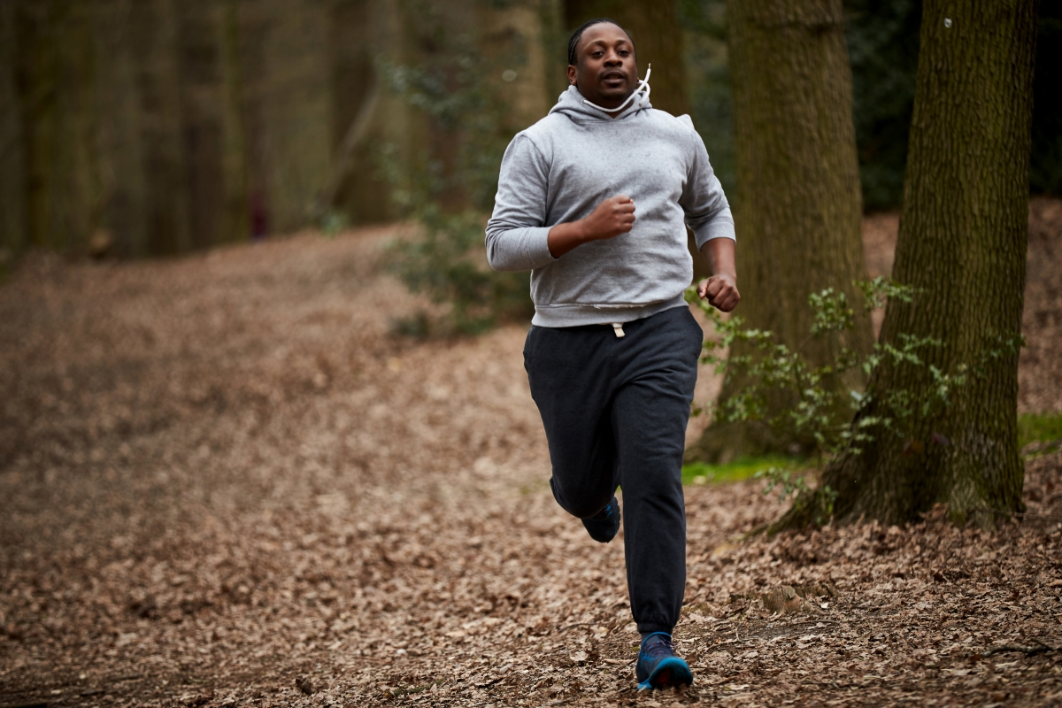 man running in woods