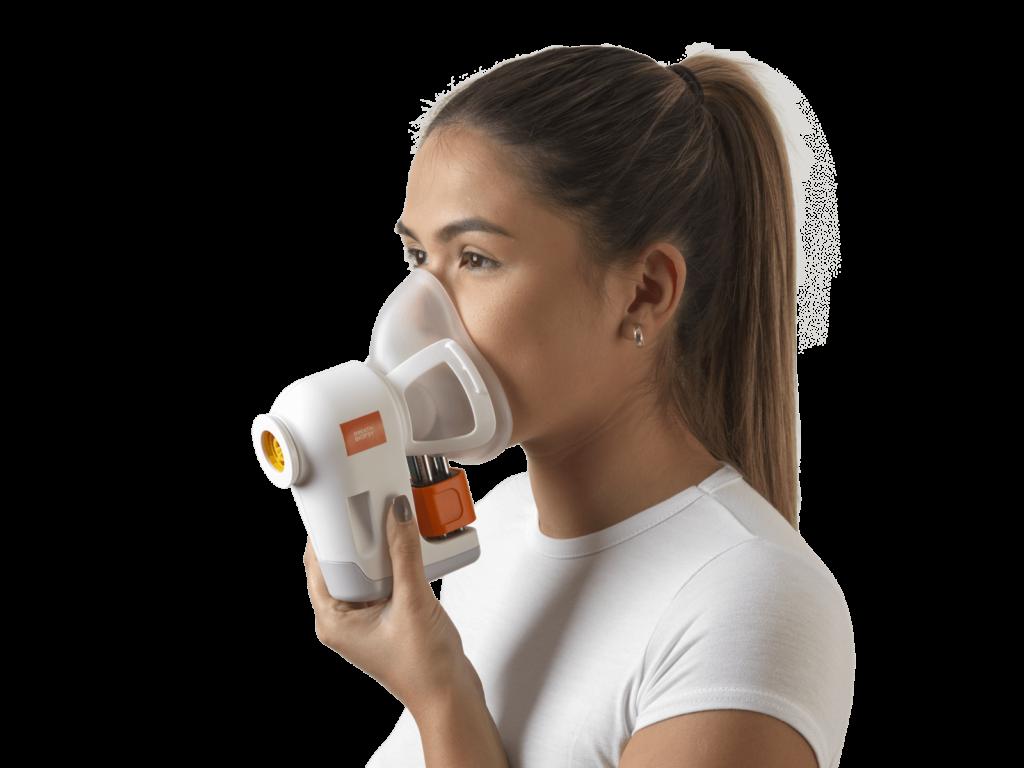 woman breathing into breath test machine