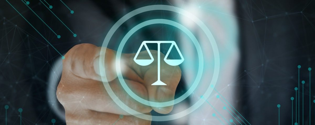 man pointing towards illsutration of legal scales